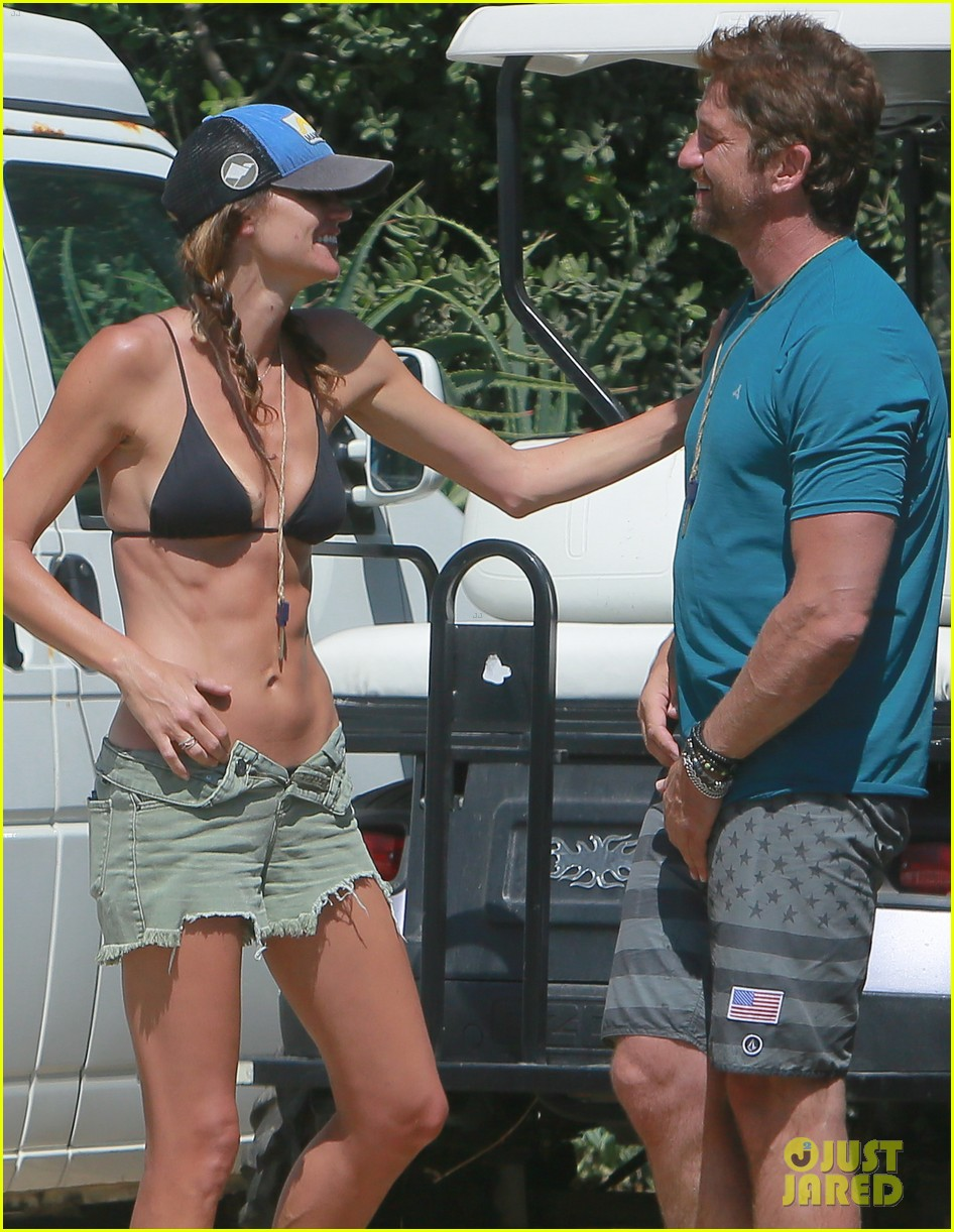 gerard butler cant keep his hands off his mystery girl 50