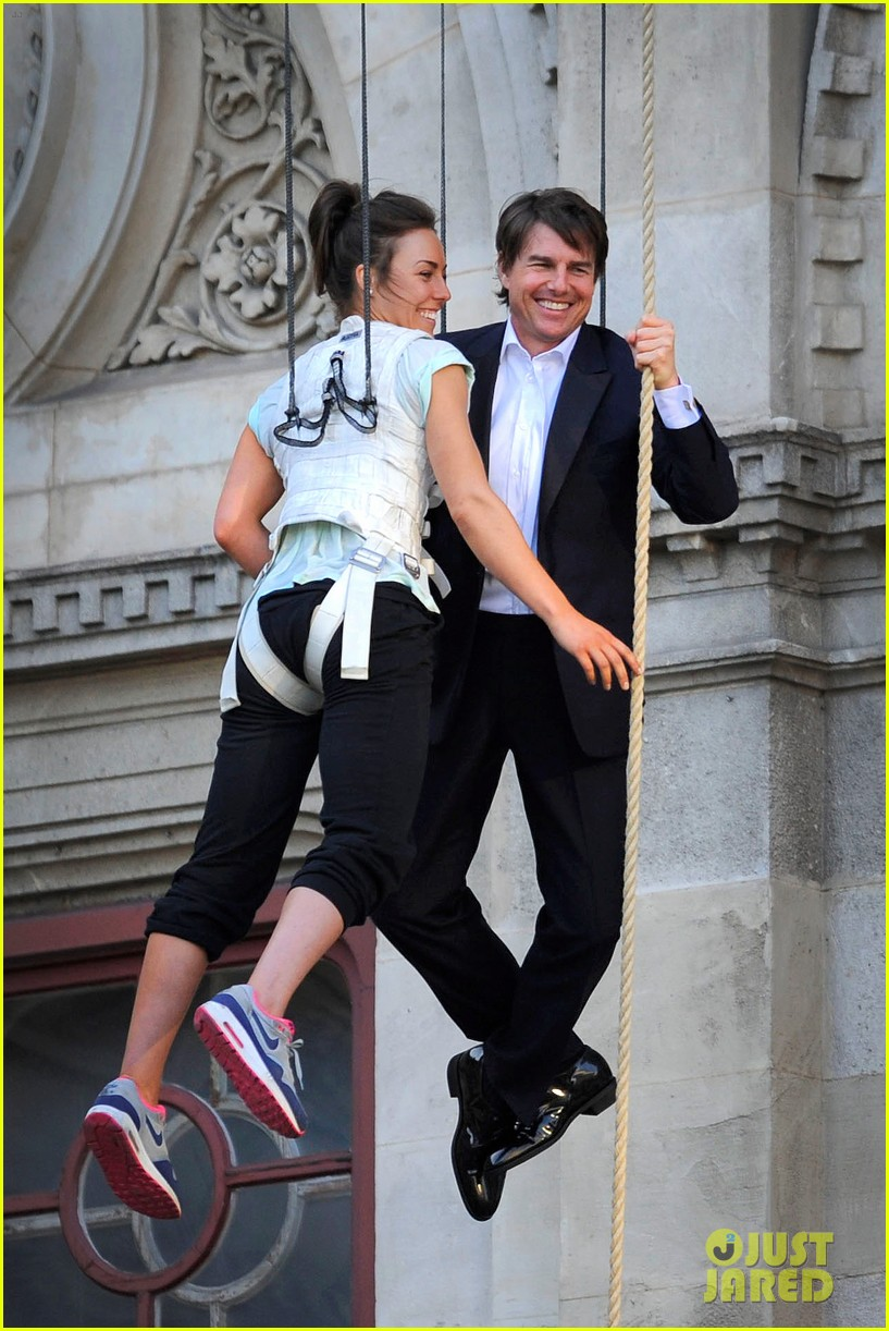 tom cruise hangs in the air with rebecca ferguson 053181709