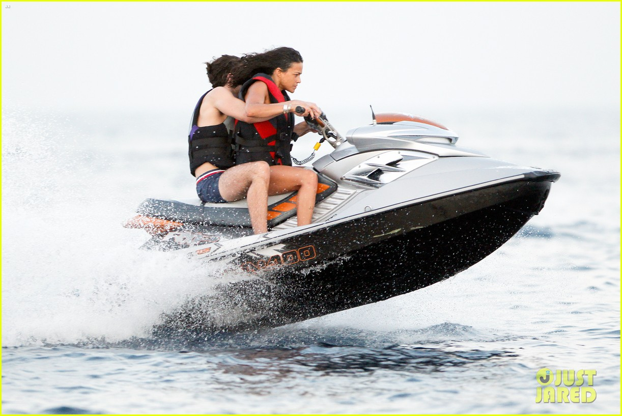 zac efron goes shirtless for jet ski fun with michelle rodriguez 083169333