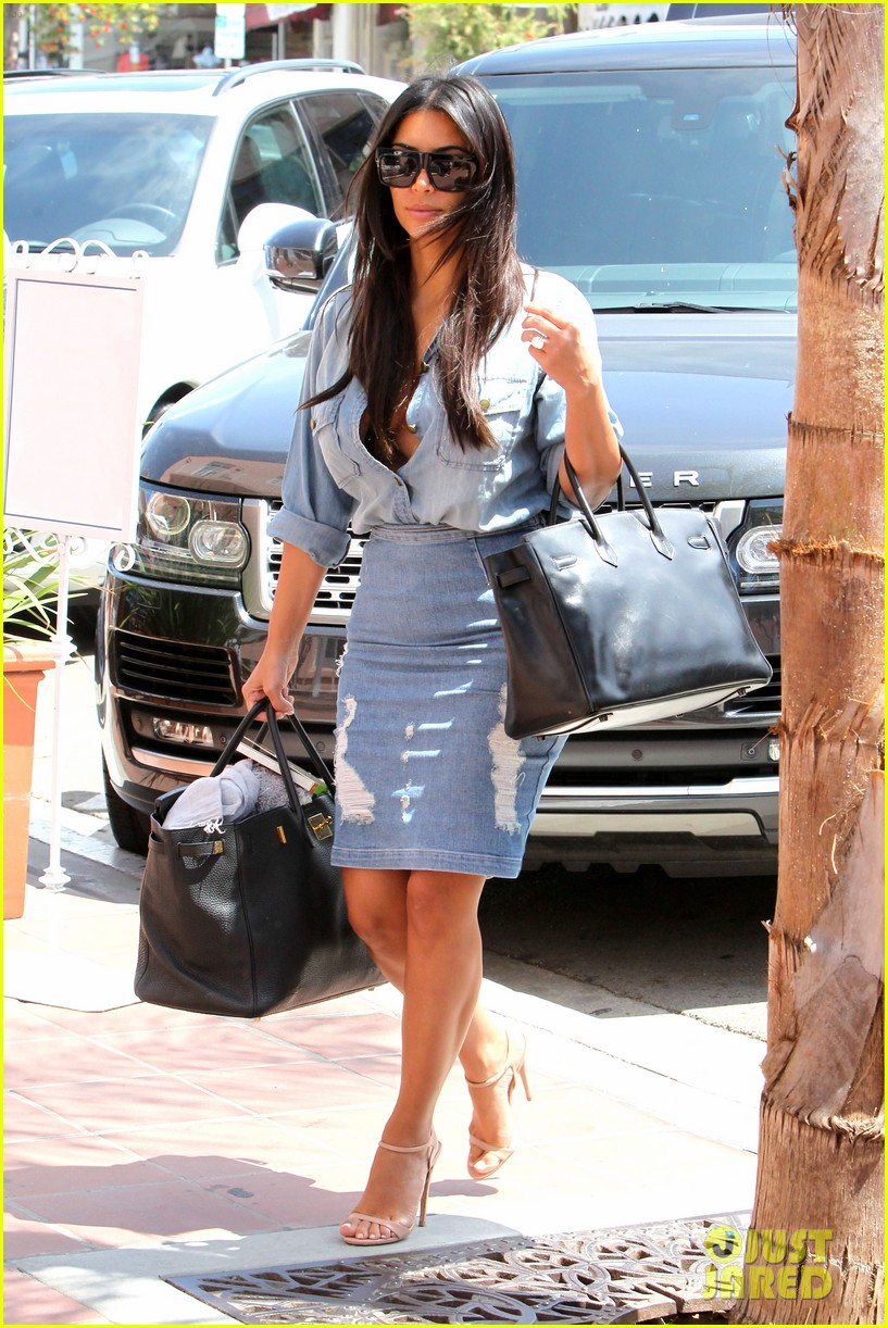 kim kardashian does double denim lots of cleavage on family outing 053181028