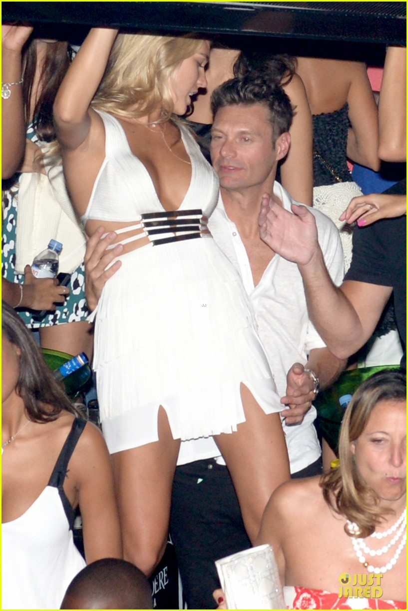 ryan seacrest pours small bucket over head 263181149