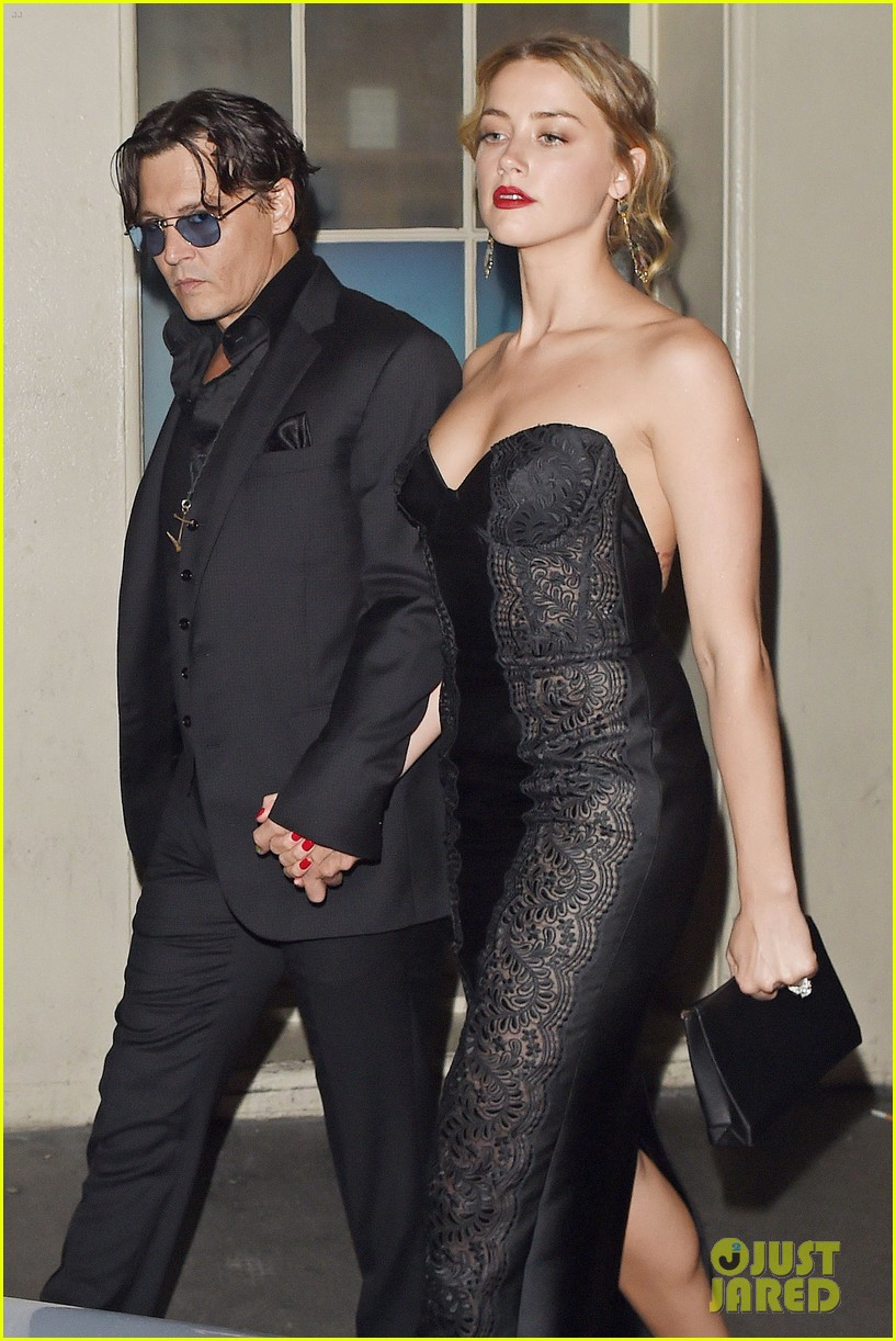 johnny depp amber heard hold hands gq men of the year awards 063189114