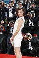 milla jovovich cradles baby bump at premiere 26