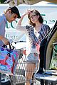 milla jovovich keeps her baby bump covered with baggy shirt 02
