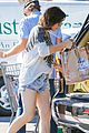 milla jovovich keeps her baby bump covered with baggy shirt 06