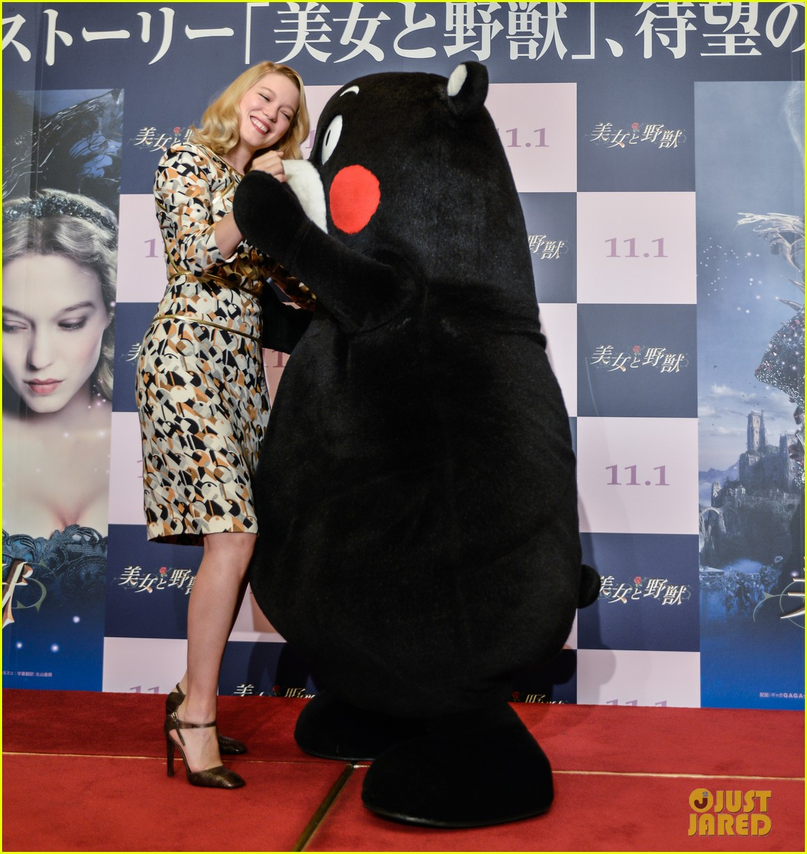 lea seydoux snuggles mascot kumamon at beauty and the beast 033189028