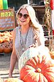 leann rimes lifts a huge pumpkin 02