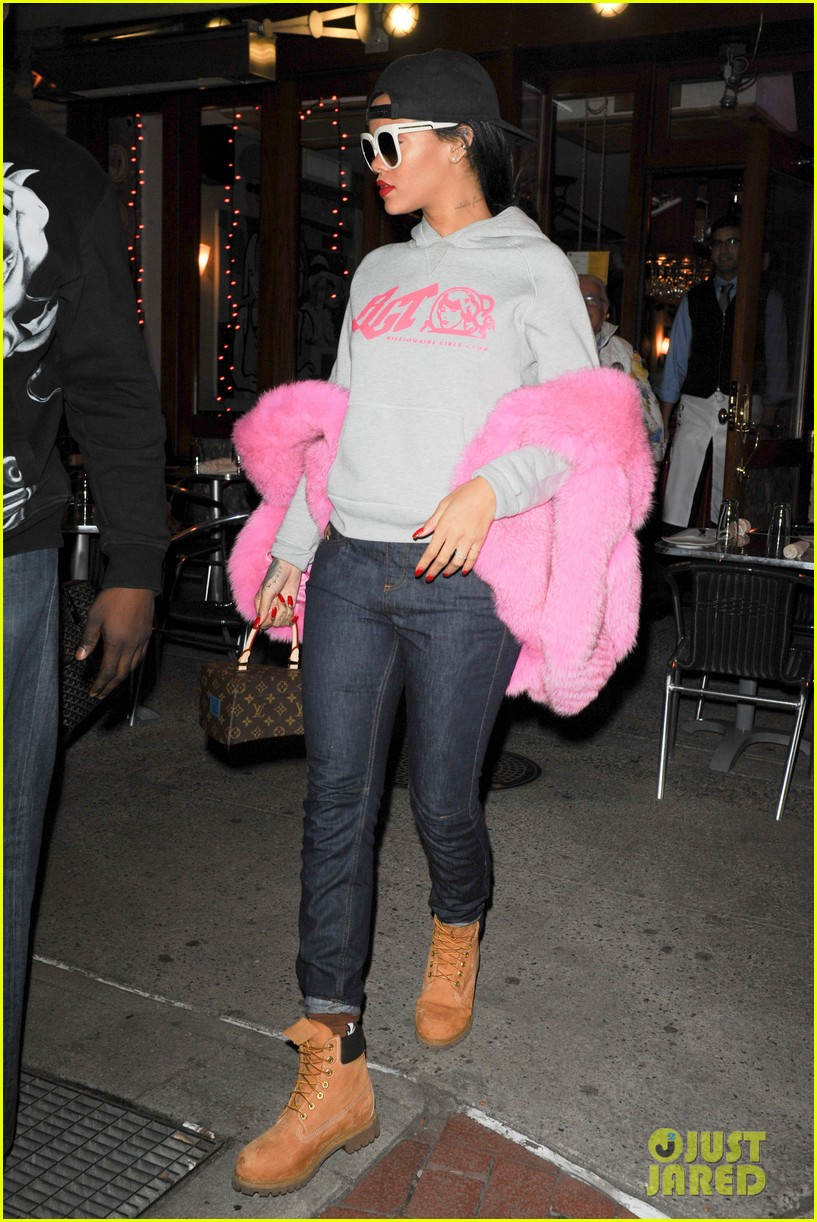 rihanna is all wrapped up in pink fur 013236285