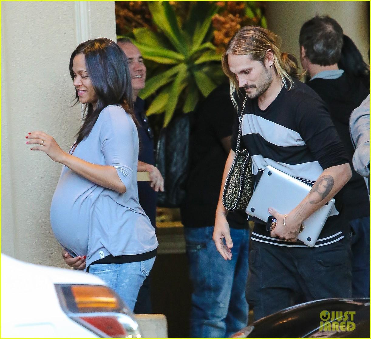 Pregnant Zoe Saldana Keeps Her Baby Bump Looking Chic Photo