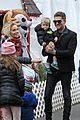 michael buble takes his son noah to a christmas theme park 14