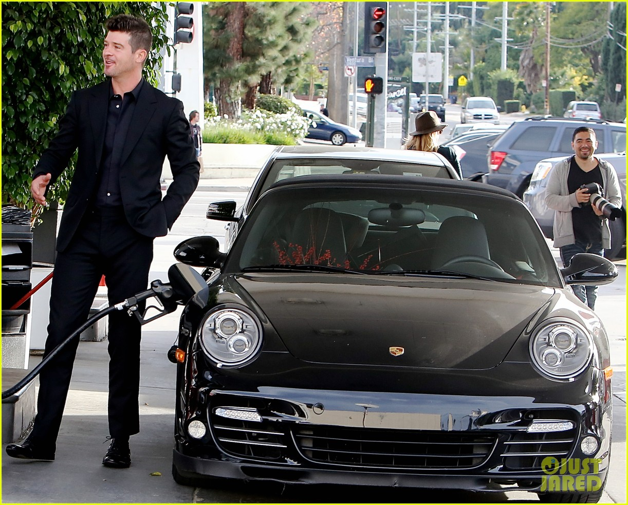 robin thicke takes young girlfriend to liquor store 103268414