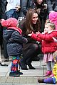 kate middleton steps out with growing baby bump to visit the fostering 01