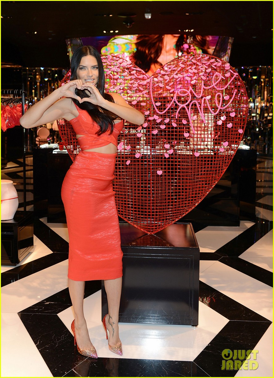 adriana lima red hot cleavage baring dress 133295175