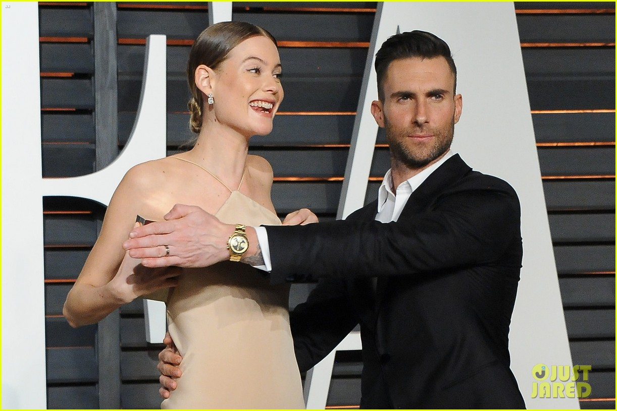adam levine hides behati prinsloos nip slip at oscars party 013312512