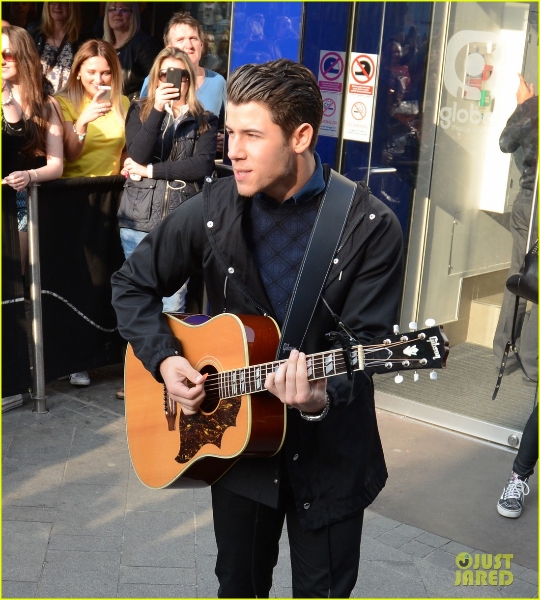 Nick jonas makes surprise appearance at westfield london amp performs