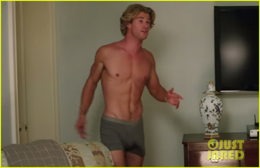 chris hemsworth is shirtless amp shows his assets in