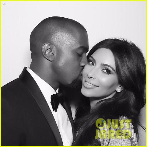 Kim Kardashian & Kanye West Share a Tongue Kiss in Wedding