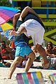 miles teller keleigh sperry kiss beach jonah hill movie hug 22