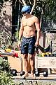 orlando bloom goes shirtless for outdoor swim weights workout 13