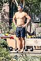 orlando bloom goes shirtless for outdoor swim weights workout 21