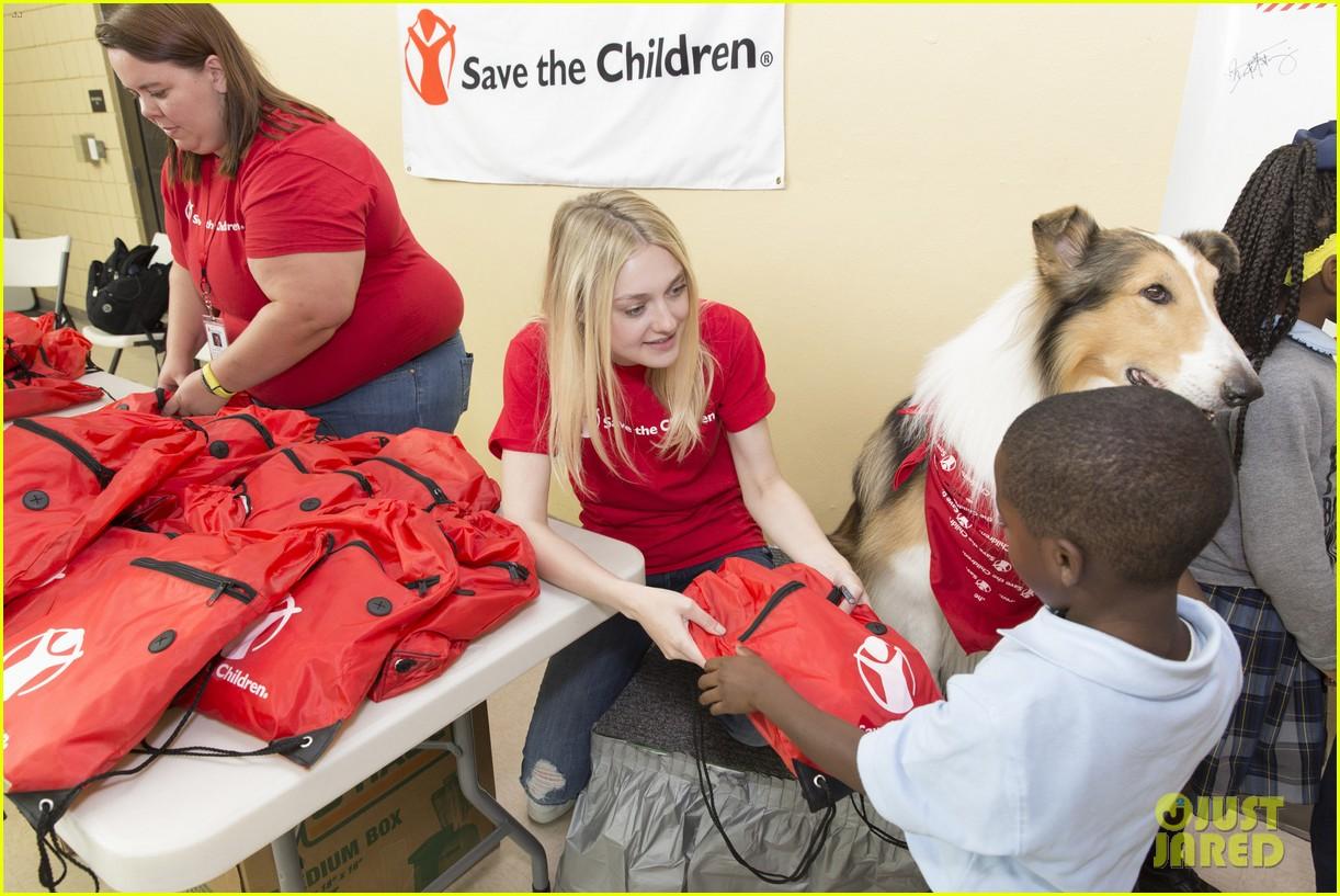 dakota fanning lassie team up at save the childrens katrina anniversary prep rally 043447237