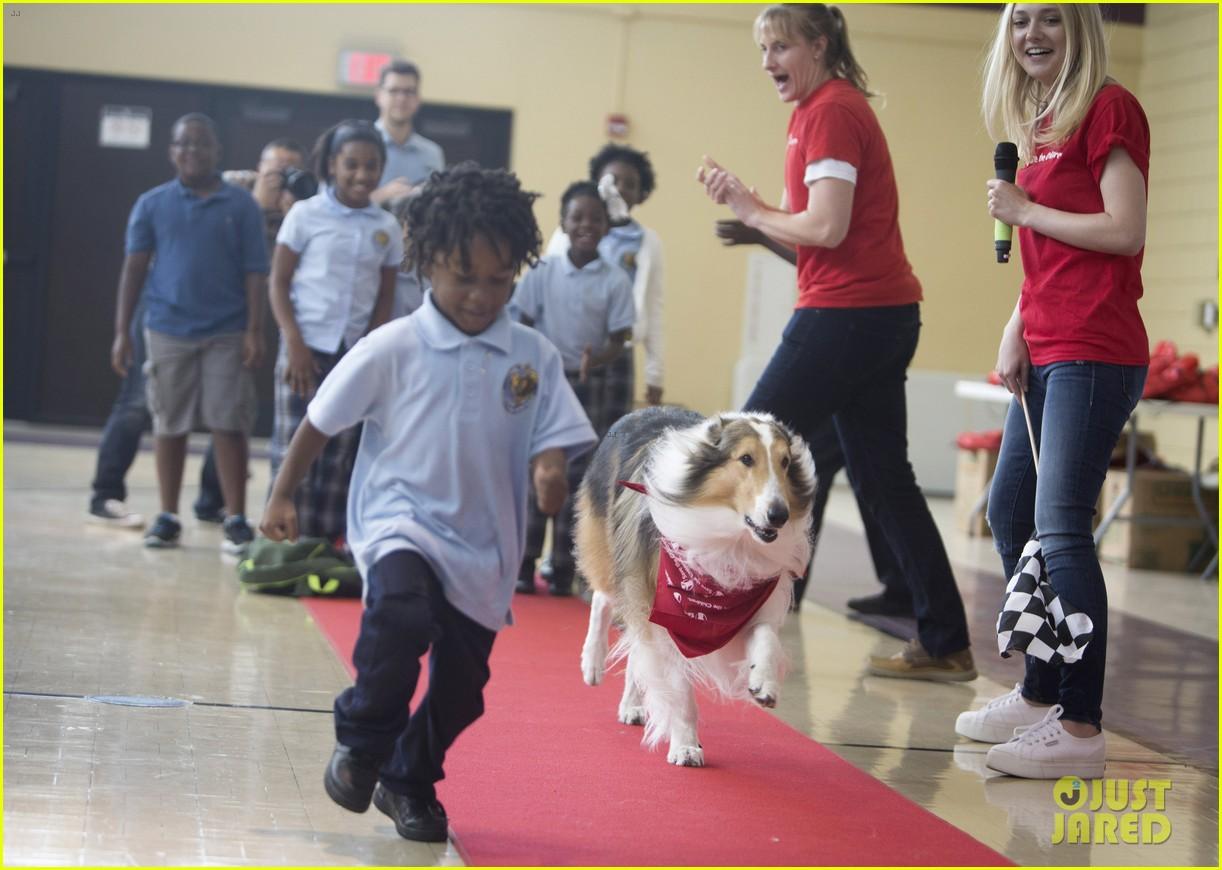 dakota fanning lassie team up at save the childrens katrina anniversary prep rally 053447238