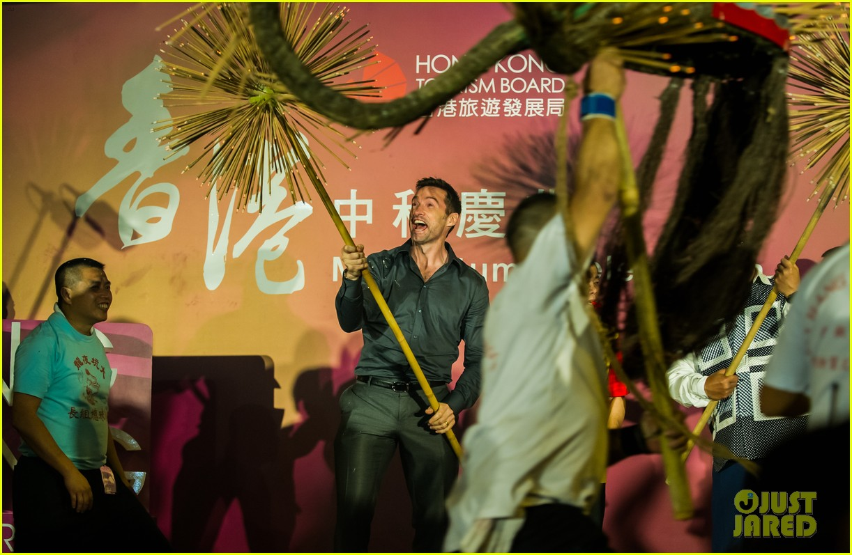 hugh jackman dances with the fire dragon in hong kong 163472722