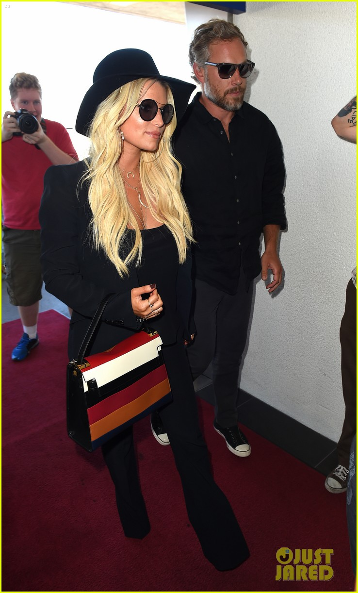 jessica simpson still has daisy dukes red boots 053454503