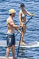 chris hemsworth flexes holds his son in new workout photo 17