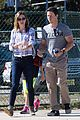 mark walhberg goofs off with wife at soccer game 01