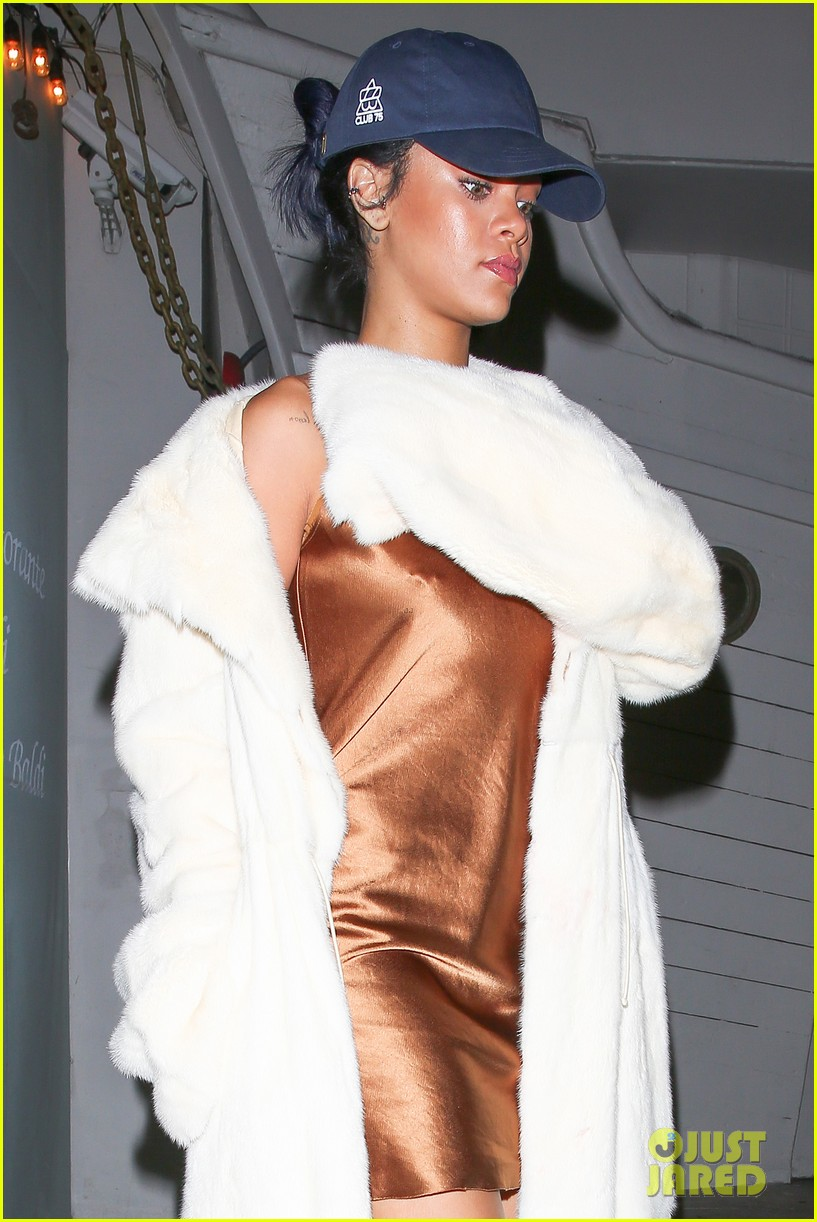 rihanna stuns in short gold dress 253507043