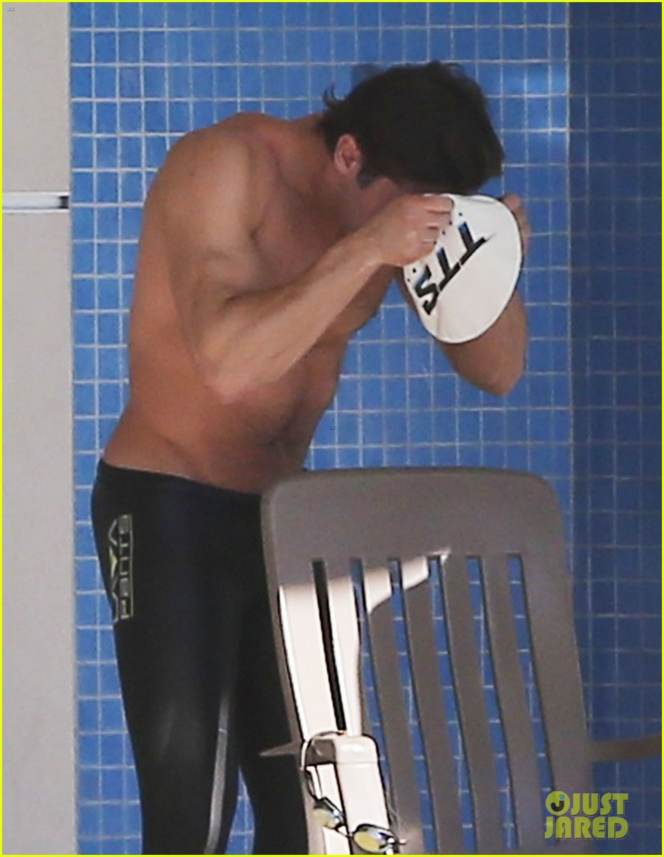 zac efron goes shirtless for baywatch swimming lessons 093557846