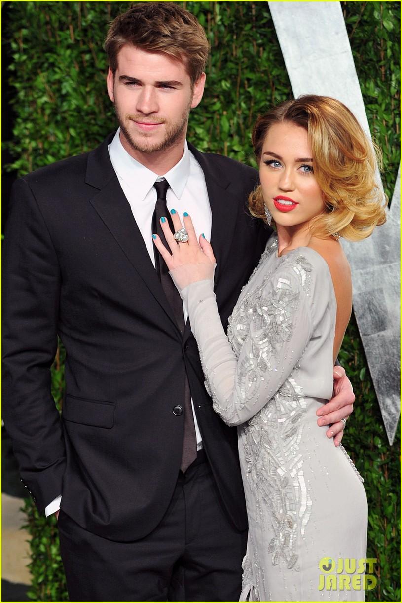 Miley Cyrus & Liam Hemsworth Spotted 'Cuddling & Kissing ...