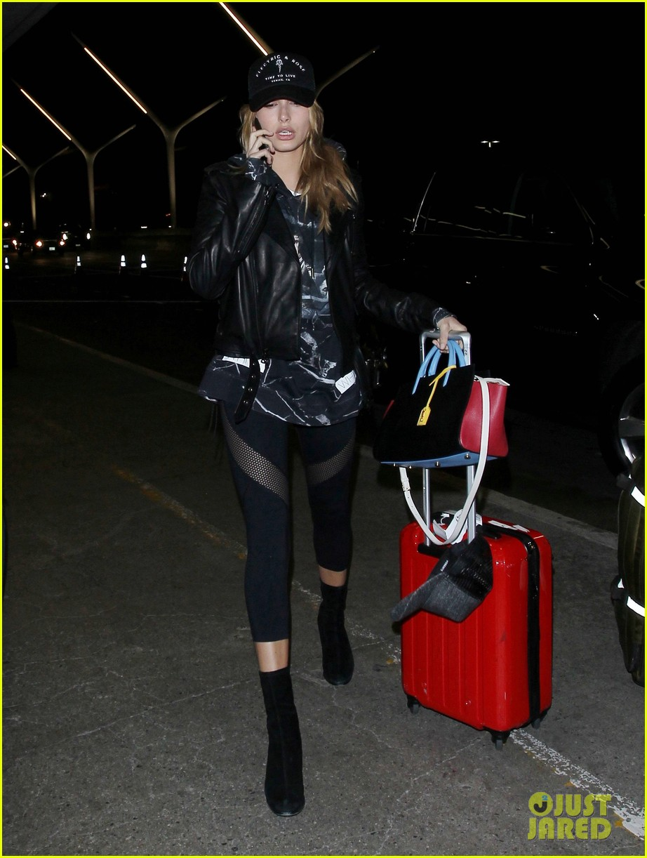 hailey baldwin pushes red carry on thru lax 153587049