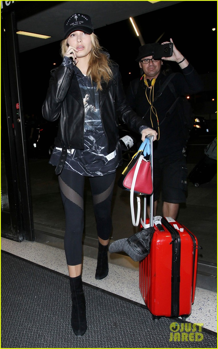 hailey baldwin pushes red carry on thru lax 183587052