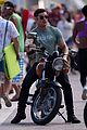 zac efron films baywatch on motorcycle 25