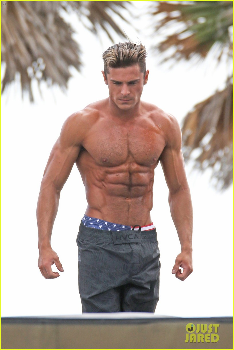 Zac Efron Uses His Rip...