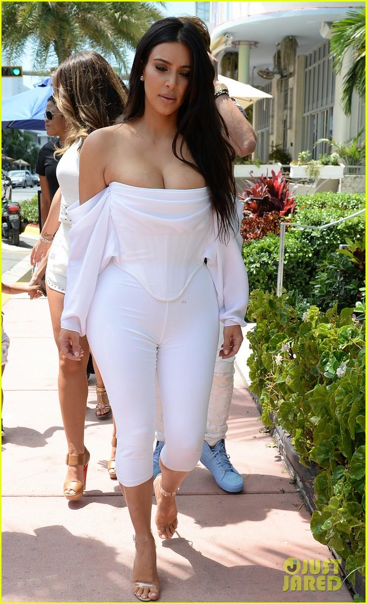 Kim Kardashian Flaunts Curves & Cleavage in White Jumpsuit: Photo ...
