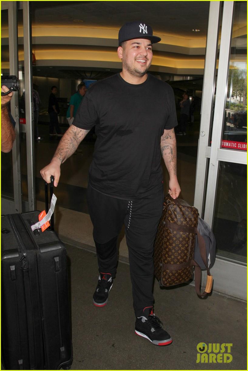 rob kardashian blac chyna land back in los angeles 023634931