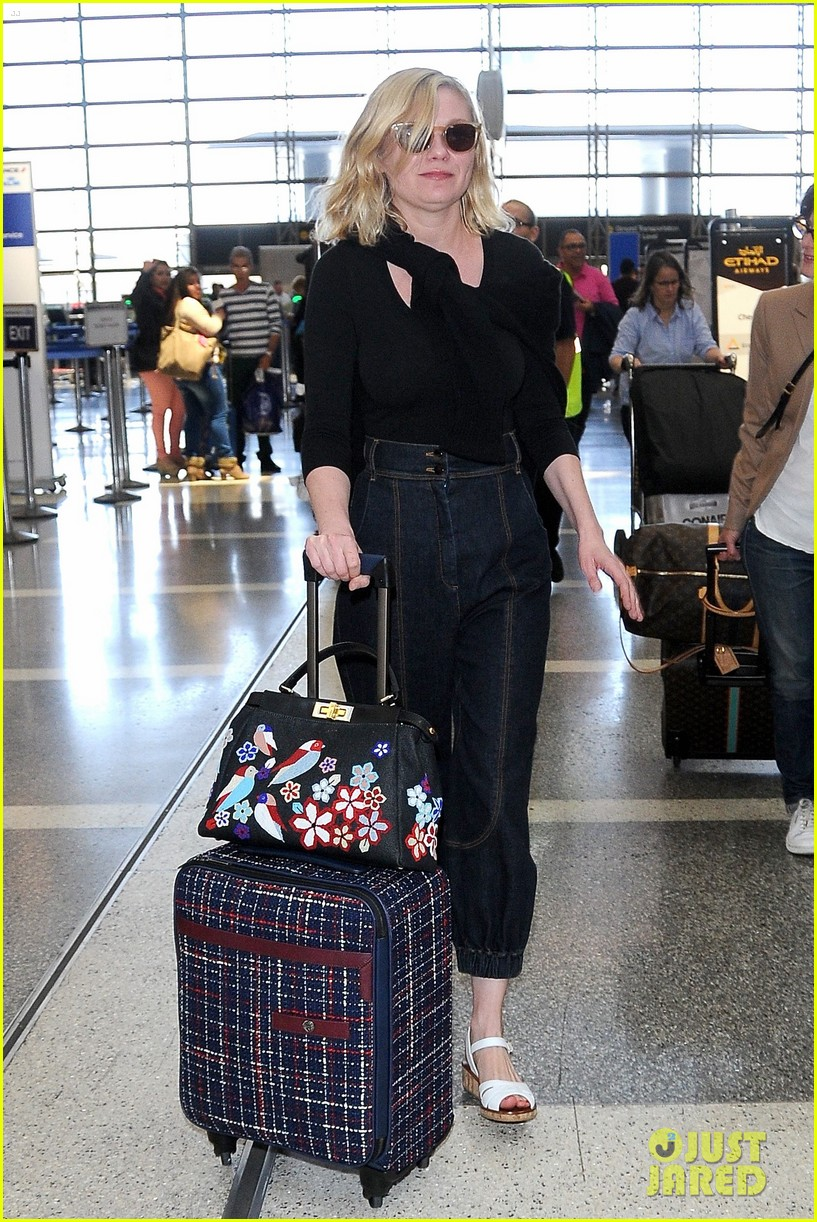 kirsten dunst catches flight out of lax 103650631