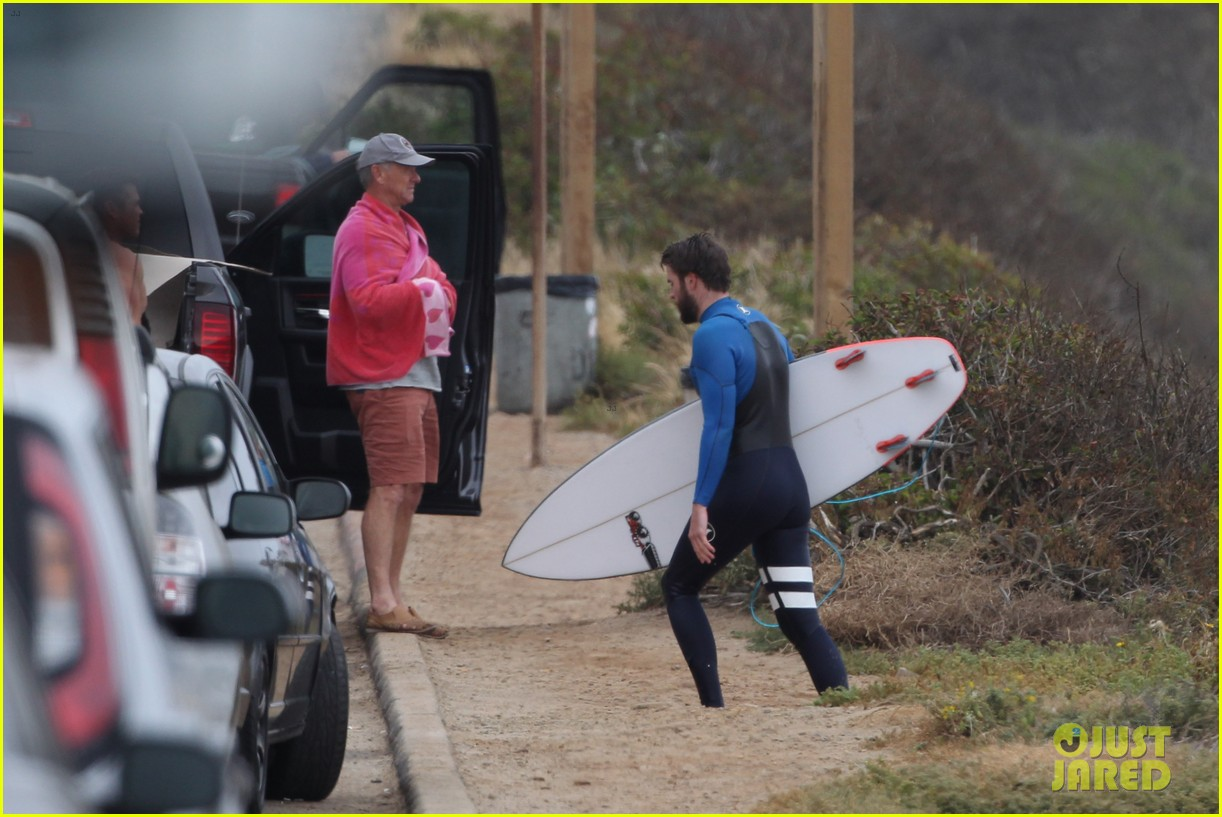 liam hemsworth strips out of his wetsuit after a surfing session 353661386