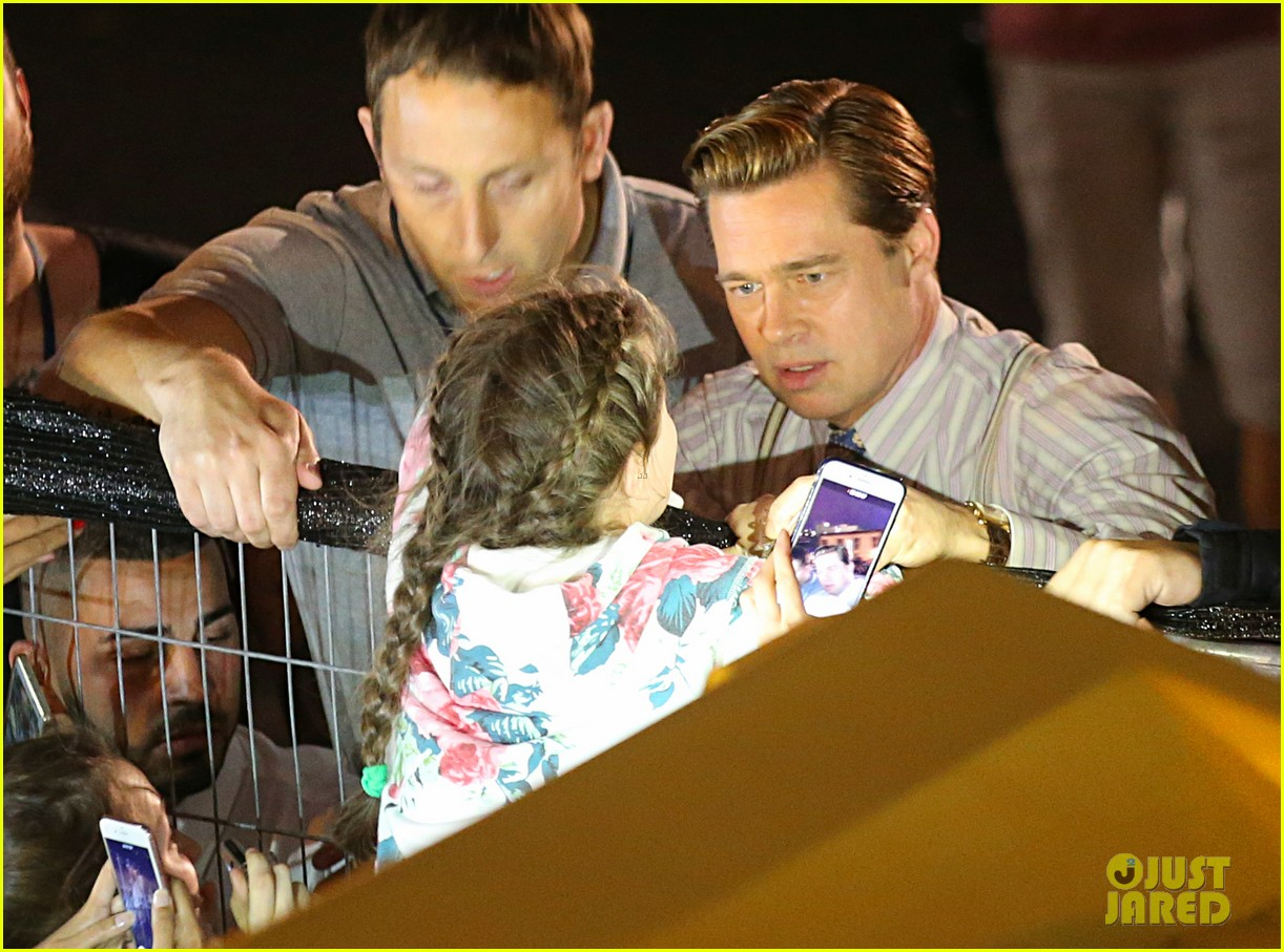 brad pitt saves little girl from being crushed by crowd 023663847