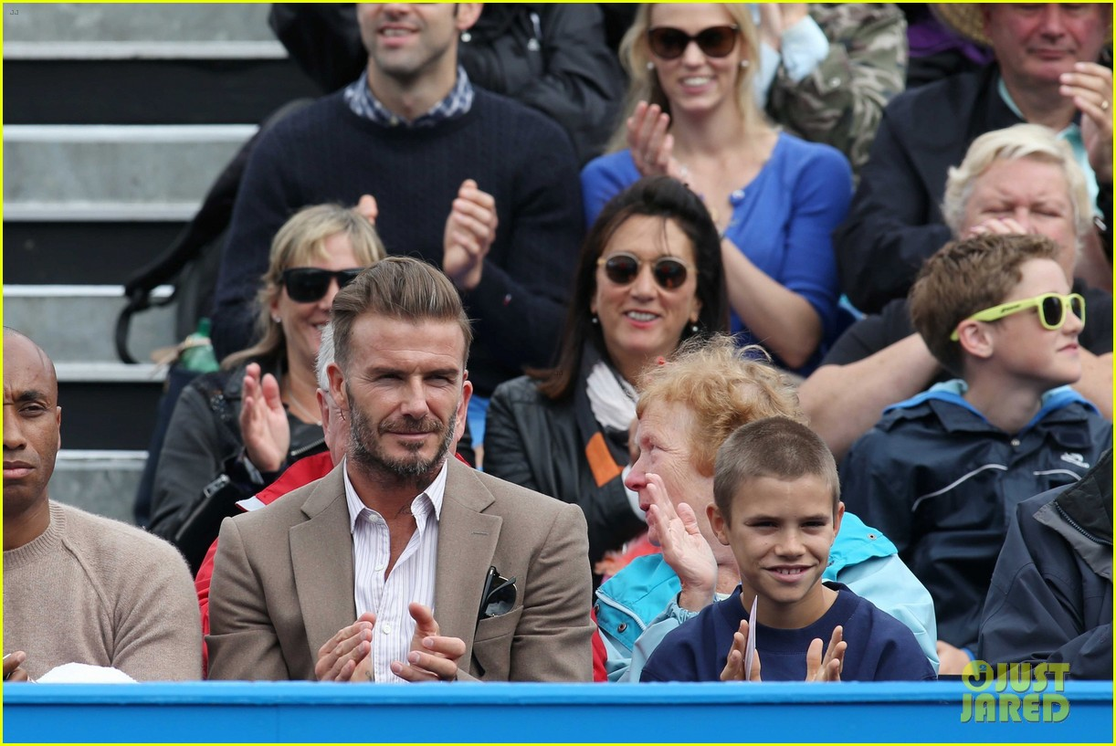 david beckham takes in a tennis match with son romeo 023682125