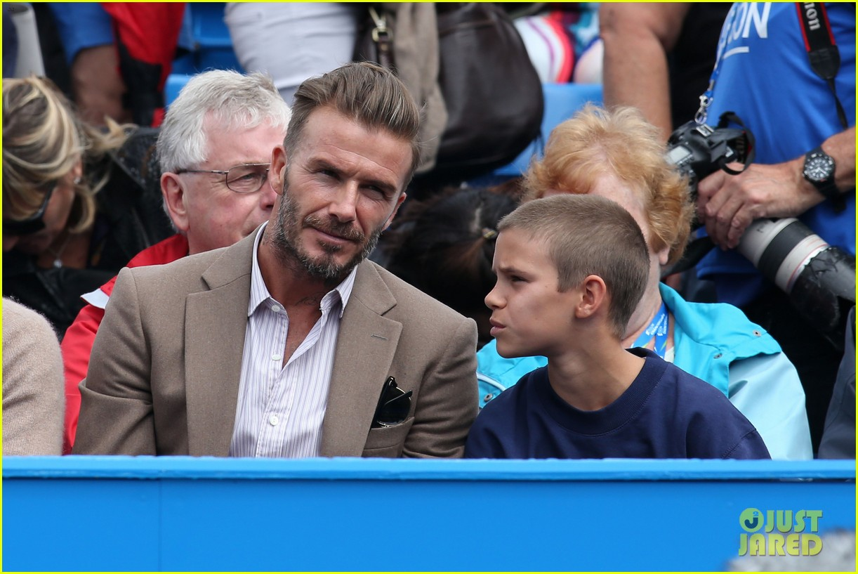 david beckham takes in a tennis match with son romeo 083682131