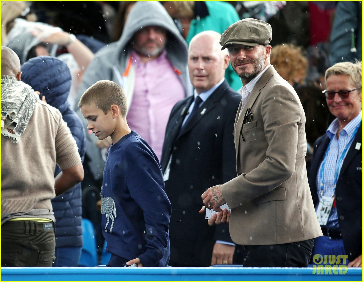 david beckham takes in a tennis match with son romeo 213682144