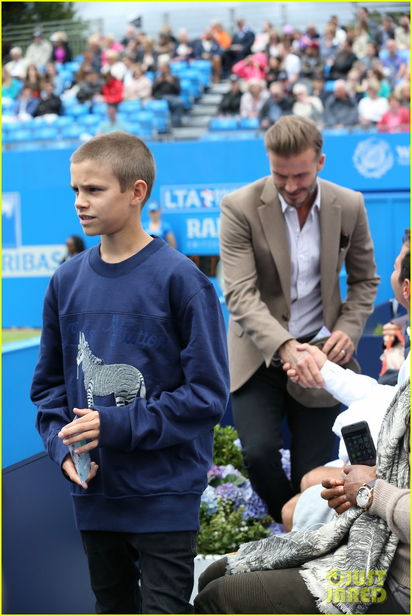david beckham takes in a tennis match with son romeo 253682148