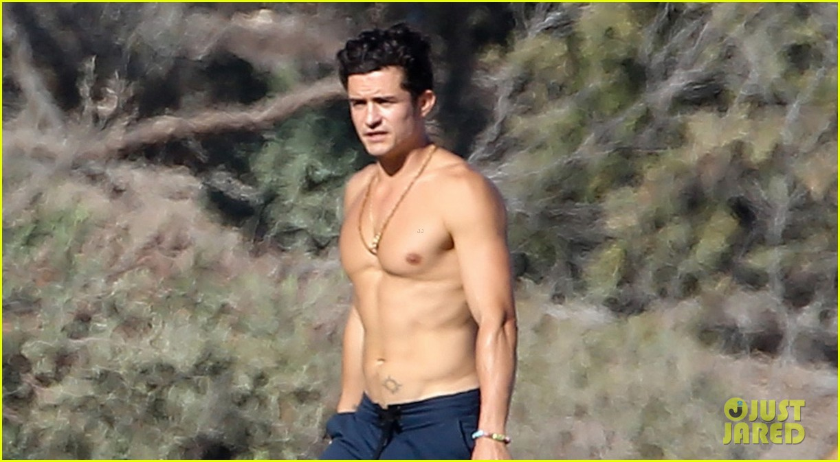 Orlando Bloom Goes Shirtless in Hot New Beach Photos