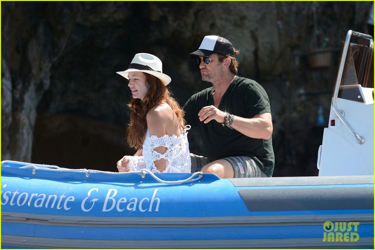 gerard butler girlfriend morgan brown romantic boat ride in italy 083706584