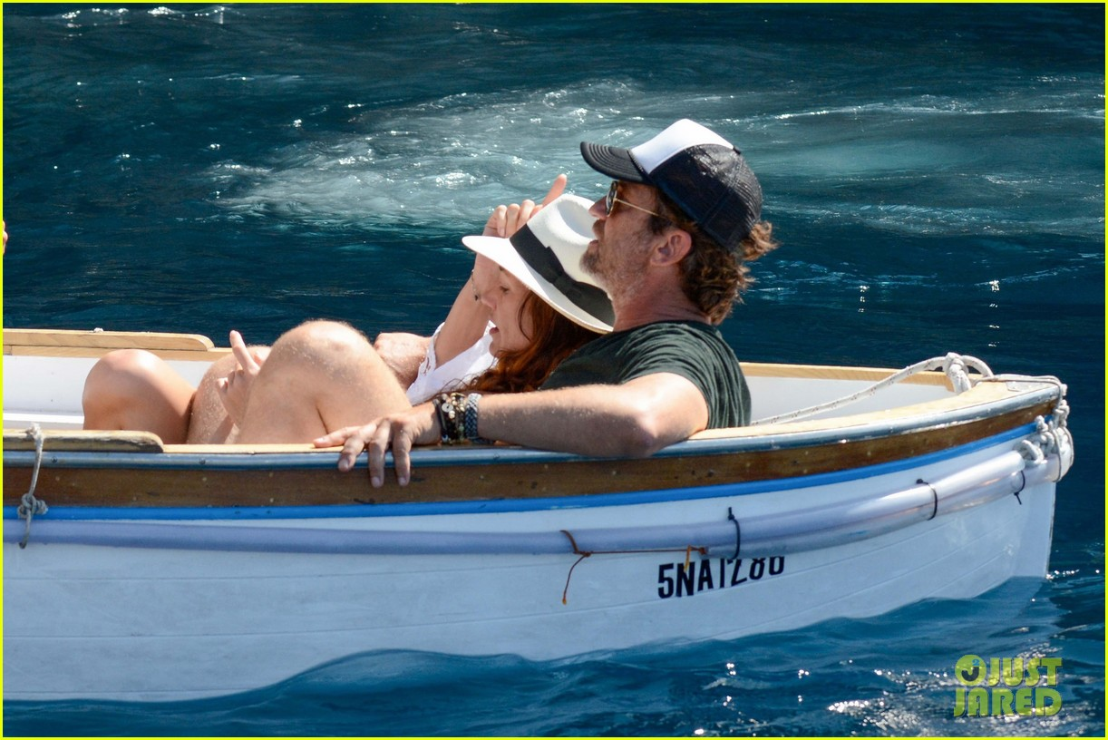 gerard butler girlfriend morgan brown romantic boat ride in italy 203706596