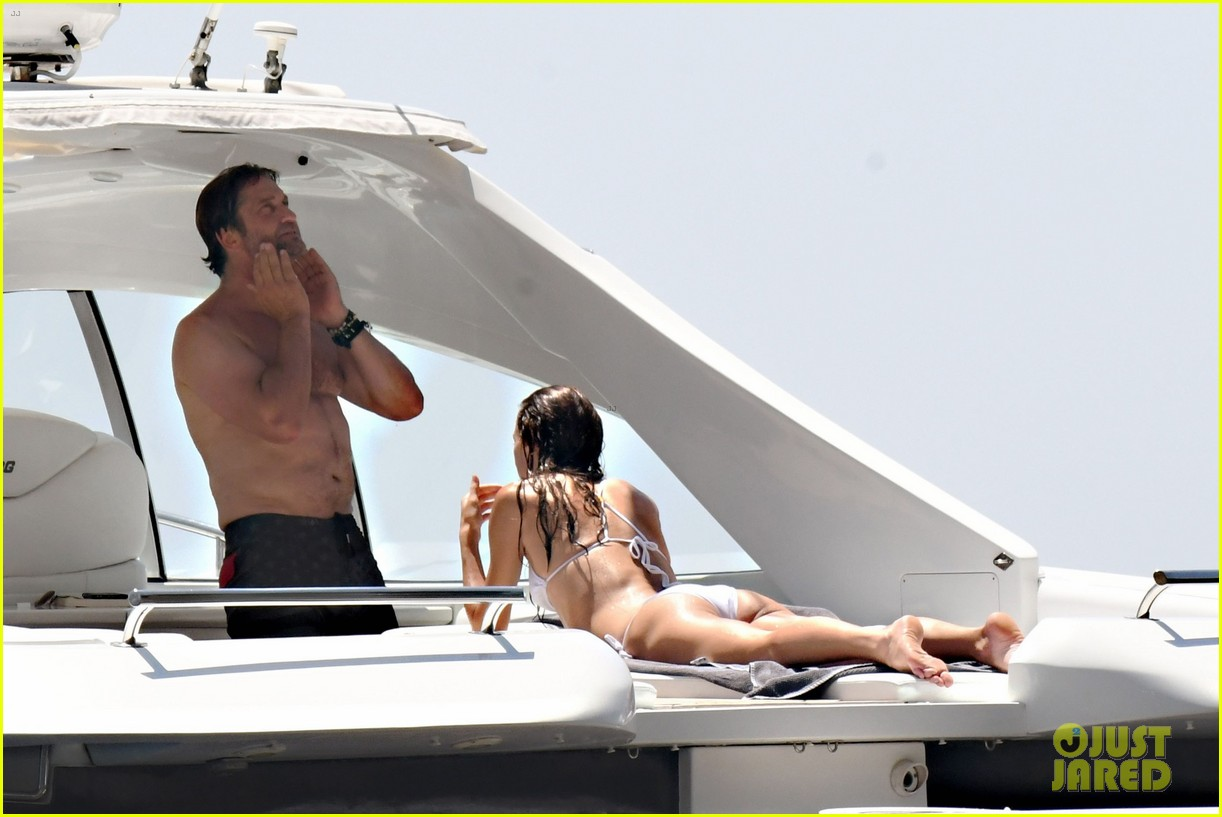 gerard butler girlfriend morgan brown romantic boat ride in italy 293706605